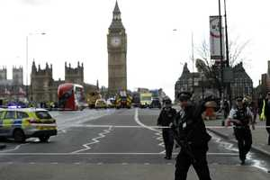 """Police secure the area on the south side of Westminster Bridge close to the Houses of Parliament in London, Wednesday, March 22, 2017. The leader of Britain's House of Commons says a man has been shot by police at Parliament. David Liddington also said there were """"reports of further violent incidents in the vicinity."""" London's police said officers had been called to a firearms incident on Westminster Bridge, near the parliament. Britain's MI5 says it is too early to say if the incident is terror-related."""