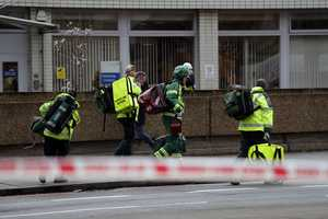 "Emergency service workers arrive on the scene  close to the Houses of Parliament in London, Wednesday, March 22, 2017. The leader of Britain's House of Commons says a man has been shot by police at Parliament. David Liddington also said there were ""reports of further violent incidents in the vicinity."" London's police said officers had been called to a firearms incident on Westminster Bridge, near the parliament. Britain's MI5 says it is too early to say if the incident is terror-related."
