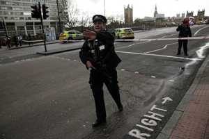 """Police secure the area close to the Houses of Parliament in London, Wednesday, March 22, 2017. The leader of Britain's House of Commons says a man has been shot by police at Parliament. David Liddington also said there were """"reports of further violent incidents in the vicinity."""" London's police said officers had been called to a firearms incident on Westminster Bridge, near the parliament. Britain's MI5 says it is too early to say if the incident is terror-related."""