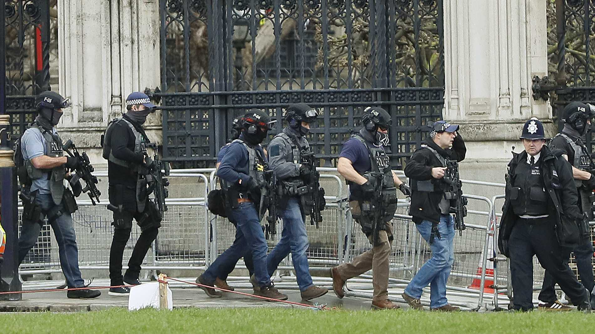 "Armed police officers enter the Houses of Parliament in London, Wednesday, March 23, 2017 after the House of Commons sitting was suspended as witnesses reported sounds like gunfire outside. The leader of Britain's House of Commons says a man has been shot by police at Parliament. David Liddington also said there were ""reports of further violent incidents in the vicinity."""