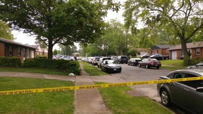 Police say mother arrested after 2 children shot in the head