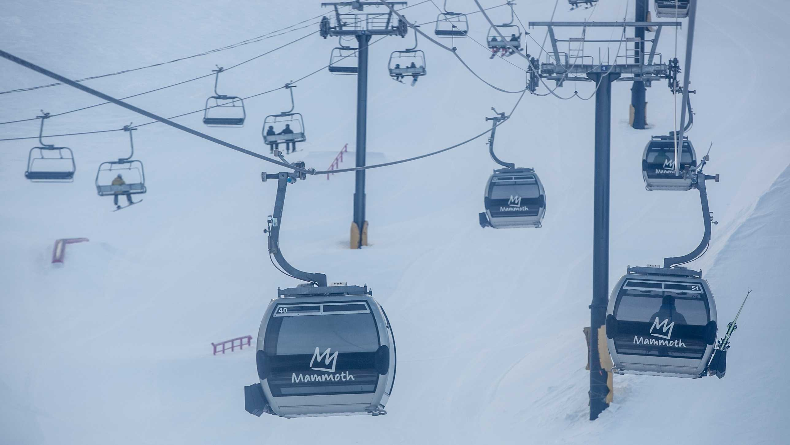 Skiers and snowboarders at Mammoth Mountain ski resort head to the top of the mountain in a gondola on January 29, 2018. Three people were partially buried but unhurt by an avalanche Saturday at the Southern California ski resort.