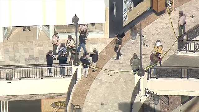 Authorities respond toThe Oaks mallin Southern California on Saturday, March 17, 2018, for a shooting in which they say a man killed his formerwife.