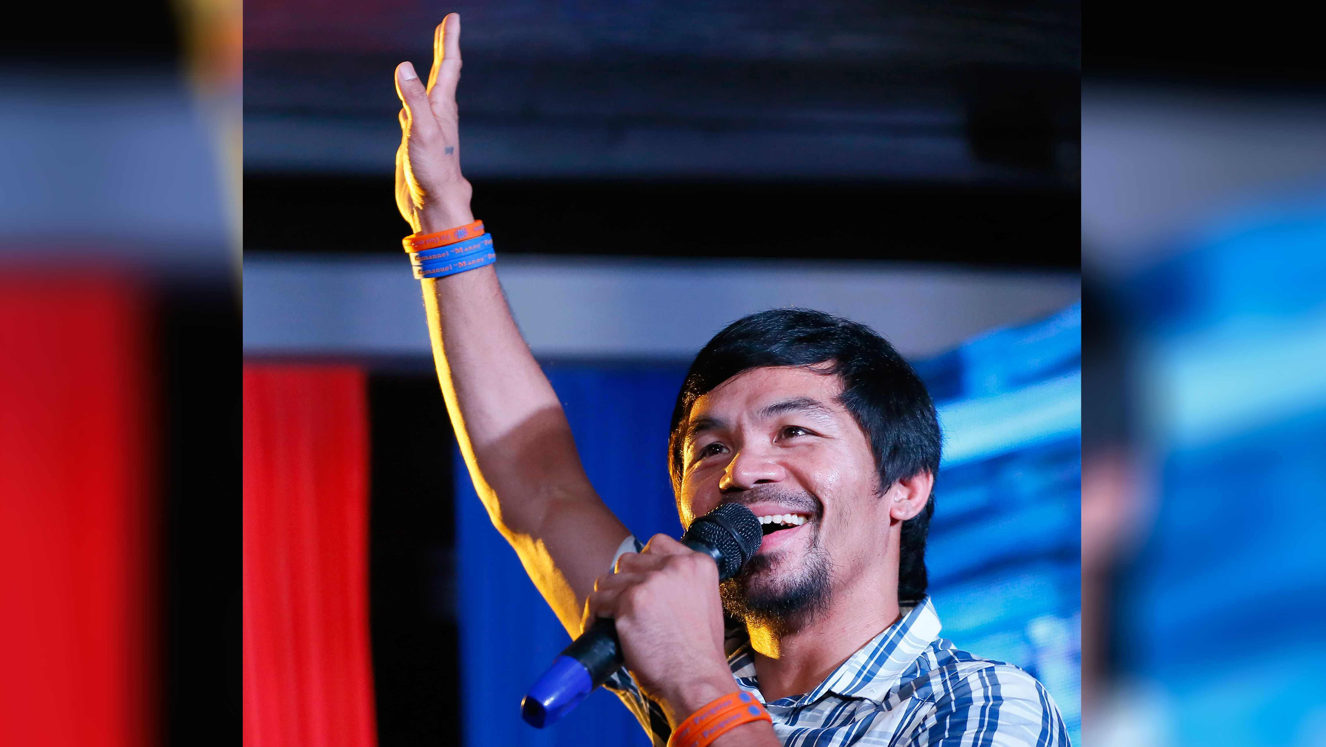 In this April 28, 2016, file photo, boxing star Manny Pacquiao addresses supporters as he campaigns for a seat in the Philippine Senate in San Pablo city, Laguna province, Philippines. Pacquiao was concentrating on trying to get the death penalty restored in the Philippines. Now he's focusing on something not nearly as controversial -- his return to the ring for a Nov. 5 fight with Jesse Vargas.