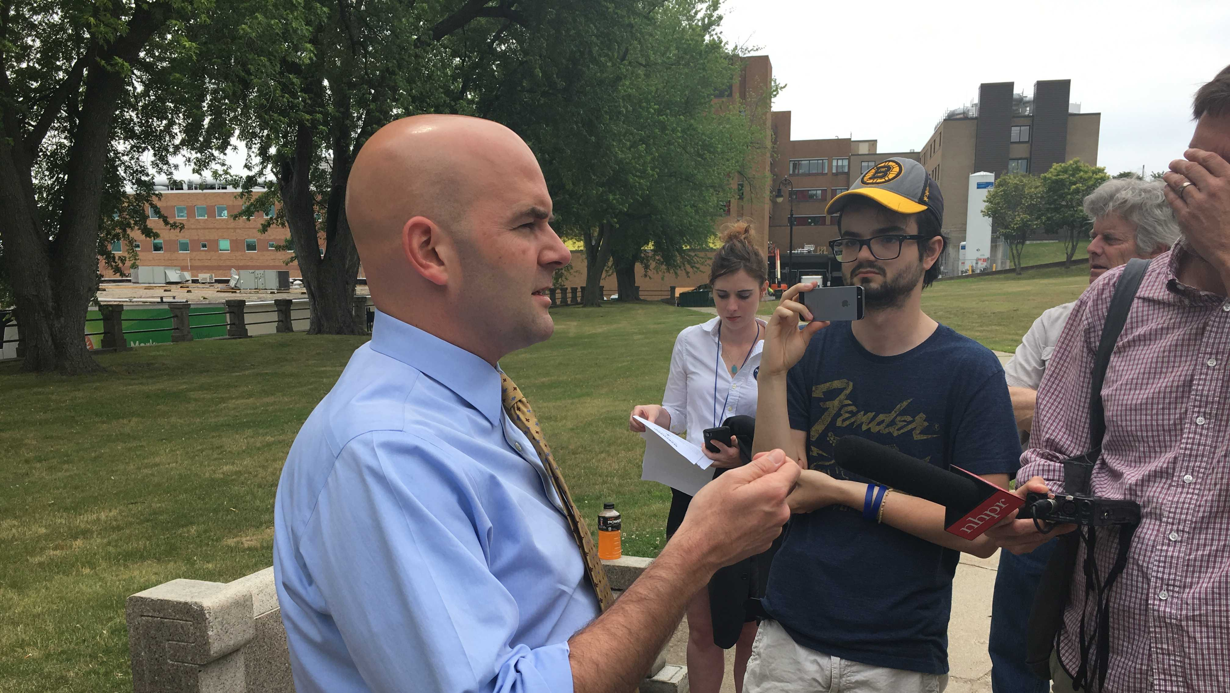 Steve Marchand unveils his immigration plan at Lafayette Park in Manchester.
