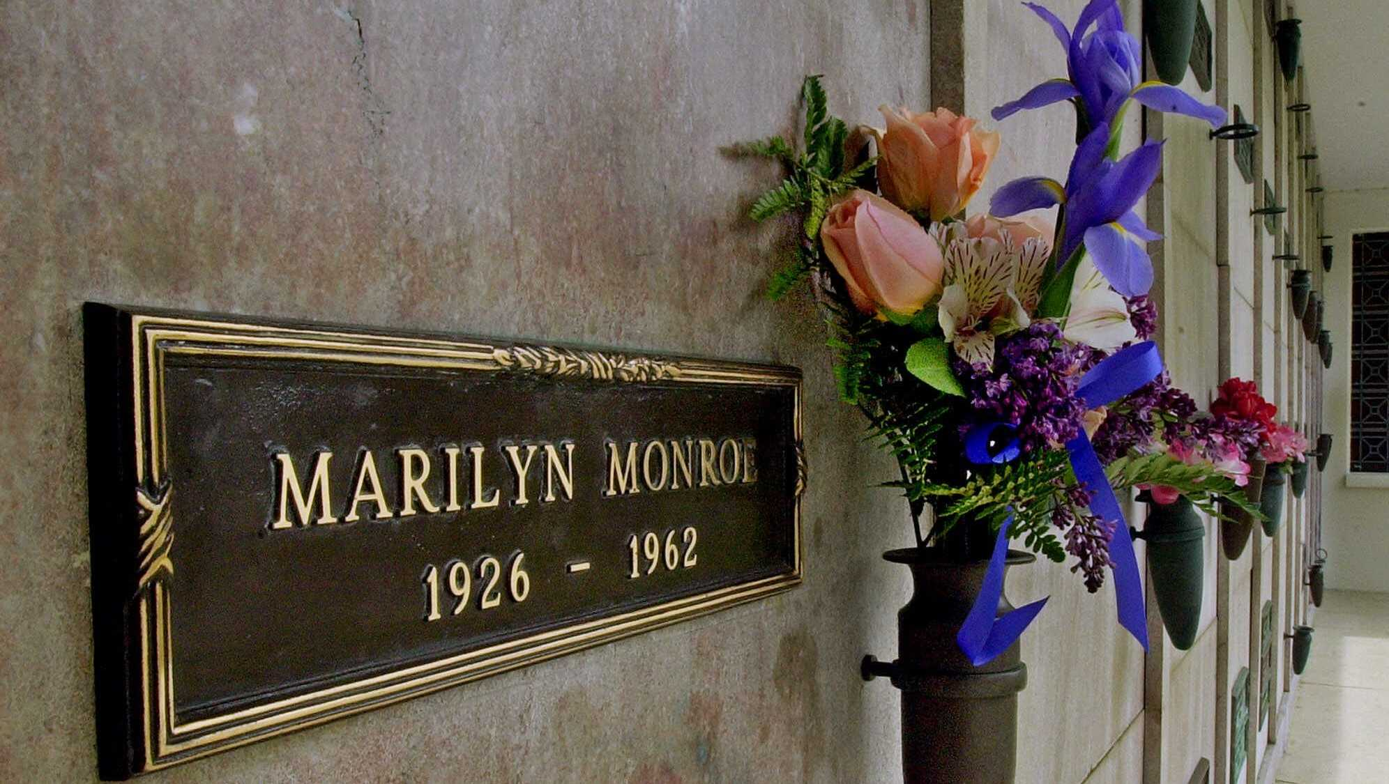 ​In this April 20, 2001 file photo, a bouquet of fresh flowers adorns the crypt of Marilyn Monroe at Westwood Village Memorial Park Cemetery in Los Angeles​