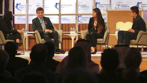 Moderator Vijita Patel, left, Parkland High School students Lewis Mizen, second left, Suzanna Barna, third left, and Kevin Trejos, right, hold a discussion on stage at the Global Education and Skills Forum in Dubai, United Arab Emirates, Saturday, March 17, 2018.