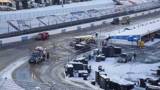 Titan Track Dryers work to clear the track at Martinsville Speedway in Martinsville, Va., Sunday, March 25, 2018. The NASCAR Cup Series race at Martinsville Speedway was postponed until Monday because of inclement weather.