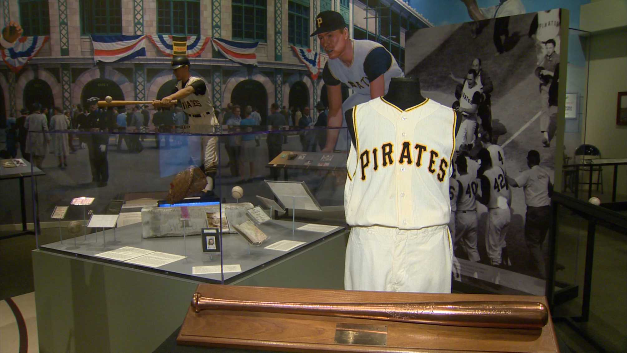 A baseball bat and Pirates uniform worn by Bill Mazeroski in the 1960 World Series.