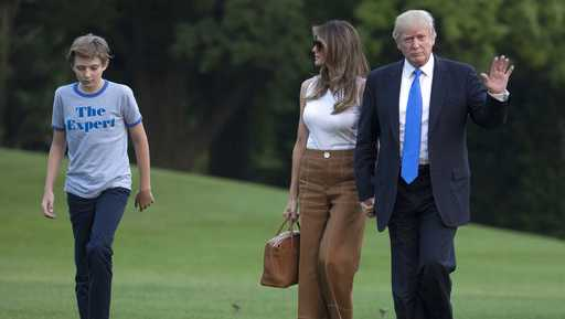 President Donald Trump waves as he walks with first lady Melania Trump and their son, Barron Trump, from Marine One across the South Lawn to the White House in Washington, Sunday, June 11, 2017, as they returned from Bedminster, N.J.