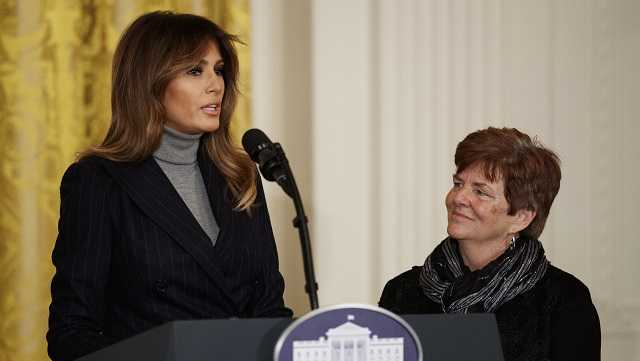 First lady Melania Trump, joined Betty Henderson of North Fort Myers, Fla., speaks at the White House Opioid Summit in the East Room of the White House, in Washington, Thursday, March 1, 2018. The first lady opened Thursday's gathering by reading from a letter from Henderson who lost her 29-year-old son to drugs last September.