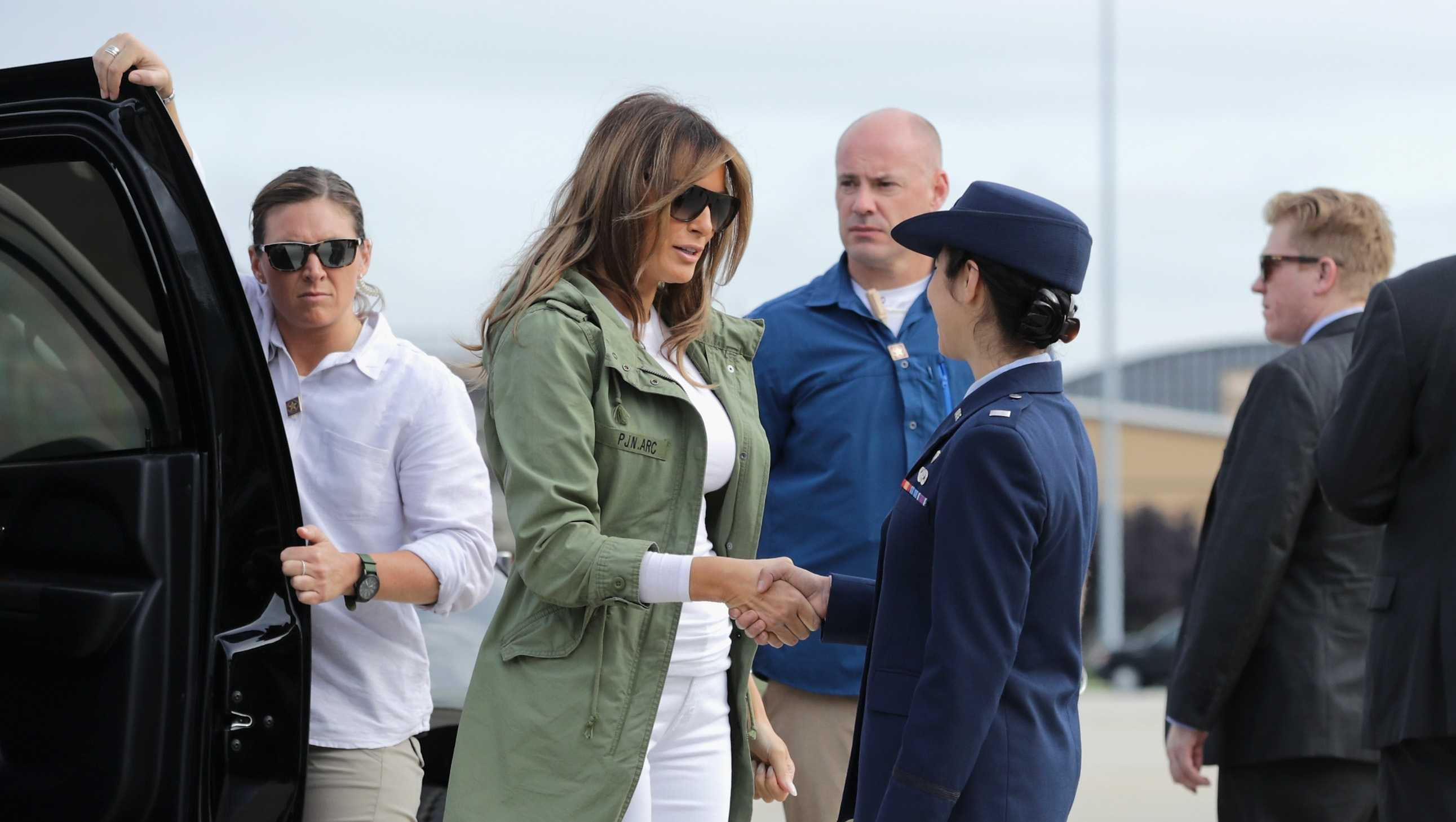 First Lady Melania Trump steps out of her motorcade before boarding an Air Force plane and traveling to Texas to visit facilities that house and care for children taken from their parents at the U.S.-Mexico border June 21, 2018 at Joint Base Andrews, Maryland.