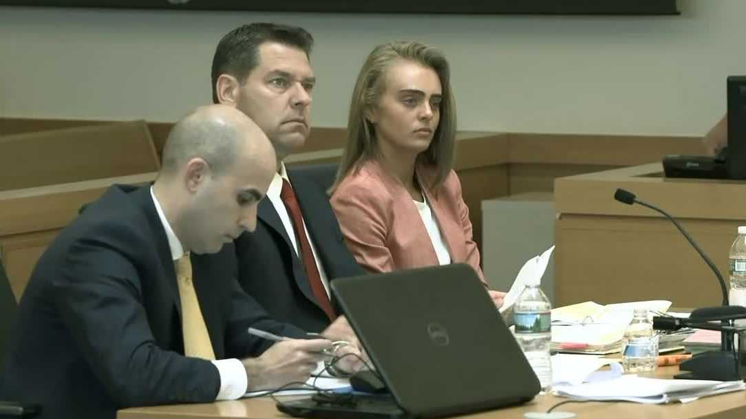 Michelle Carter sits with her lawyers in the courtroom