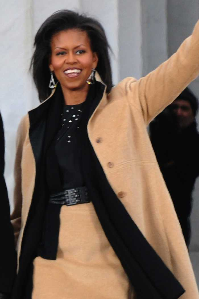 Michelle Obama waves to the crowd during the inaugural opening ceremonies at the Lincoln Memorial on the National Mall in Washington, D.C., Jan. 18, 2009.