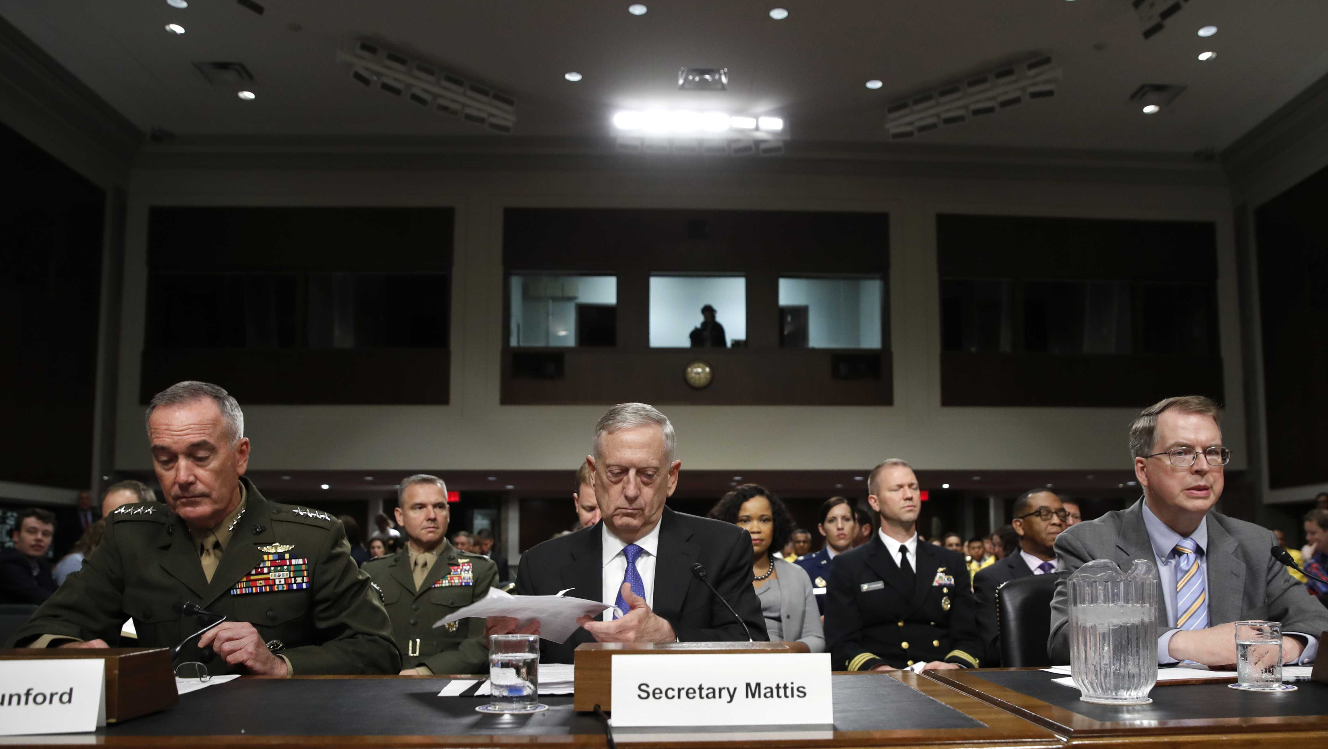 Defense Secretary Jim Mattis, center, flanked by Joint Chiefs Chairman Gen. Joseph Dunford, left, and Defense Undersecretary David Norquist, prepares to testify on Capitol Hill in Washington, Tuesday, June 13, 2017, before a Senate Armed Services Committee hearing on the defense department's budget.
