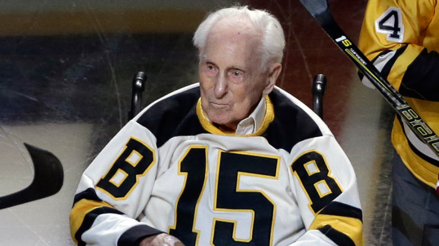 Boston Bruins hockey legend Milt Schmidt looks on after a ceremonial puck drop before an NHL hockey game between the Boston Bruins and the New Jersey Devils, Thursday, Oct. 20, 2016, in Boston.