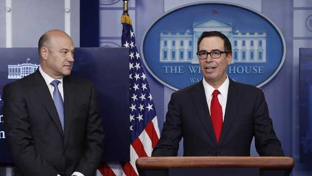 Treasury Secretary Steven Mnuchin, joined by National Economic Director Gary Cohn, speaks in the briefing room of the White House in Washington, Wednesday, April 26, 2017. President Donald Trump is proposing dramatically reducing the taxes paid by corporations big and small in an overhaul his administration says will spur economic growth and bring jobs and prosperity to the middle class.