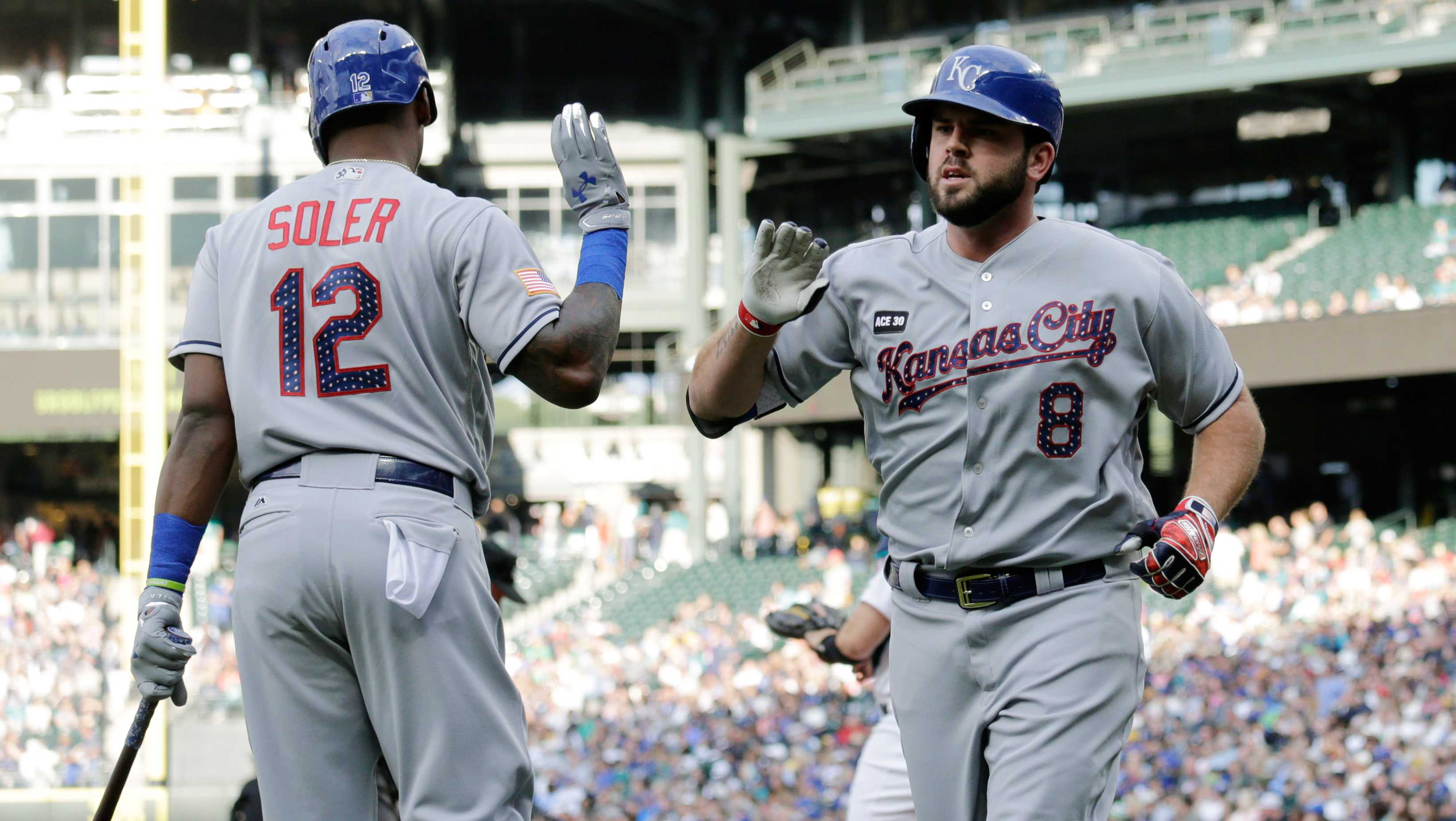 Kansas City Royals' Mike Moustakas, right, is greeted by Jorge Soler at home plate after hitting a solo home run against the Seattle Mariners during a baseball game, Monday, July 3, 2017, in Seattle. (AP Photo/John Froschauer)