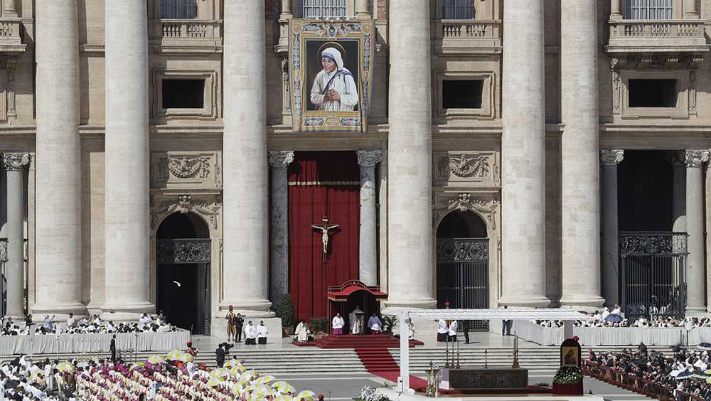 A tapestry depicting Mother Teresa hangs from the balcony of St. Peter's Basilica as Pope Francis celebrates a Canonization Mass at the Vatican on Sunday.