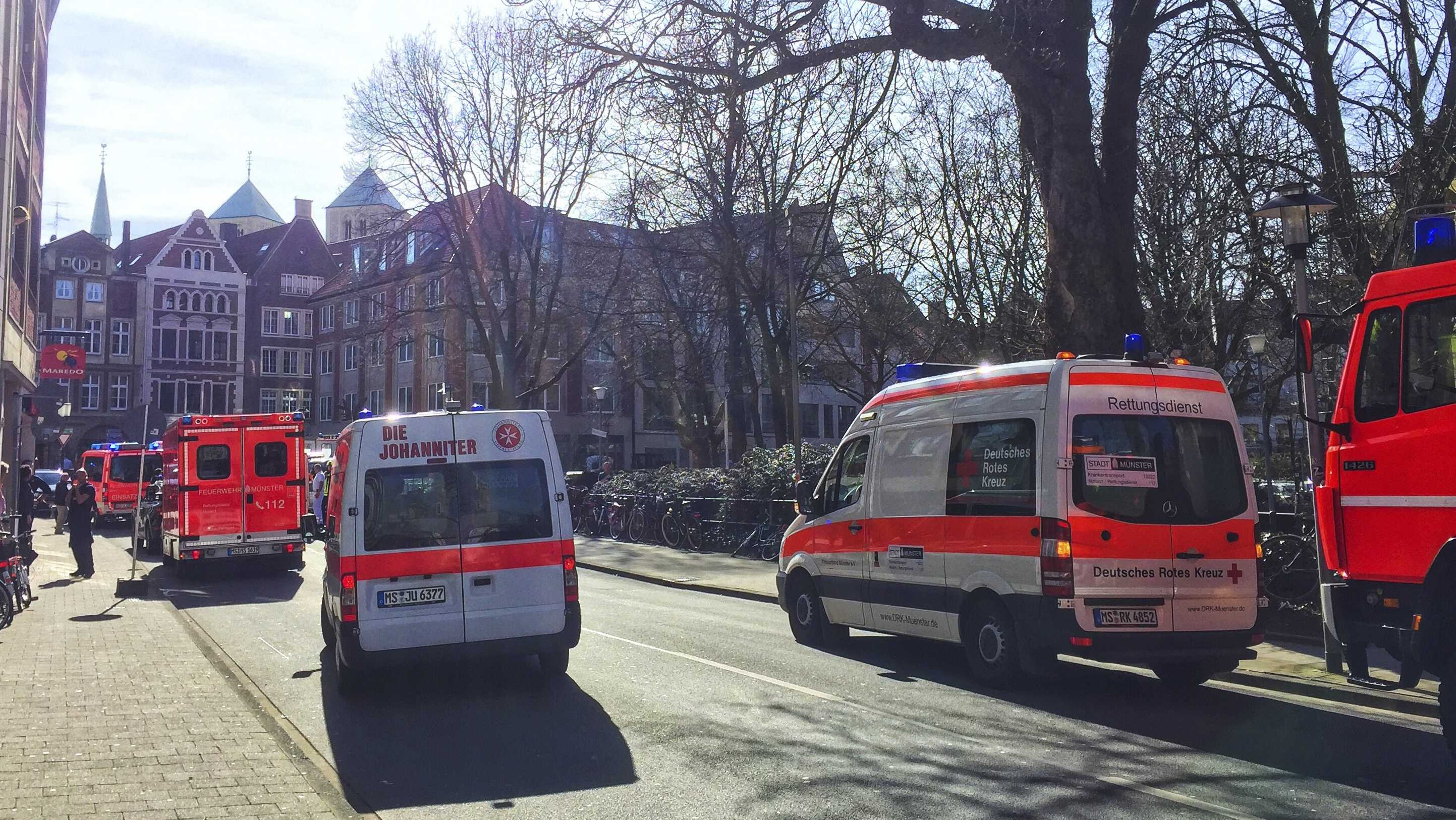 Ambulances stand in downtown Muenster, Germany, Saturday, April 7, 2018.