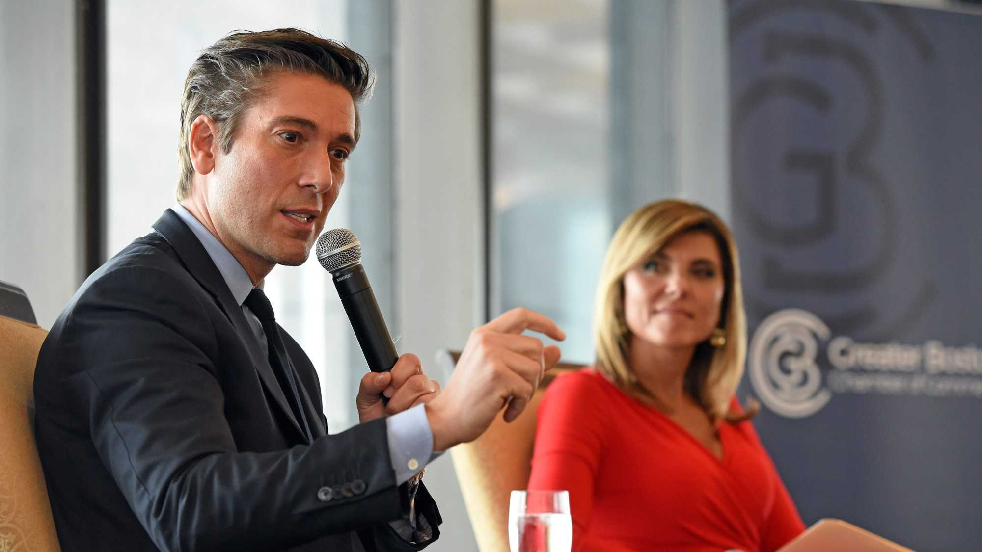 Maria Stephanos and David Muir on stage during Greater Boston Chamber of Commerce event
