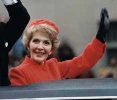 Nancy Reagan waves from the limousine during the Inaugural Parade. Washington, DC, 1981.