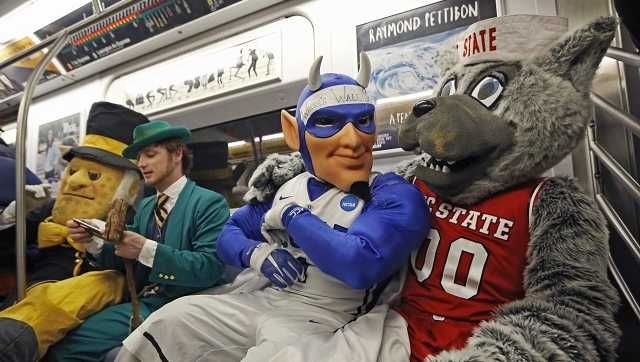 The mascots of Wake Forest, Notre Dame, Duke and North Carolina State share a subway ride in New York City on March 6, 2017.