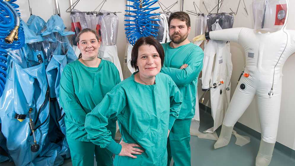 NEIDL microbiologist Elke Mühlberger (center), one of the world's leading researchers on the Ebola and Marburg viruses, senior research scientist Judith Olejnik (left), and research scientist Adam Hume are eager to get to work in the NEIDL BSL-4 lab.