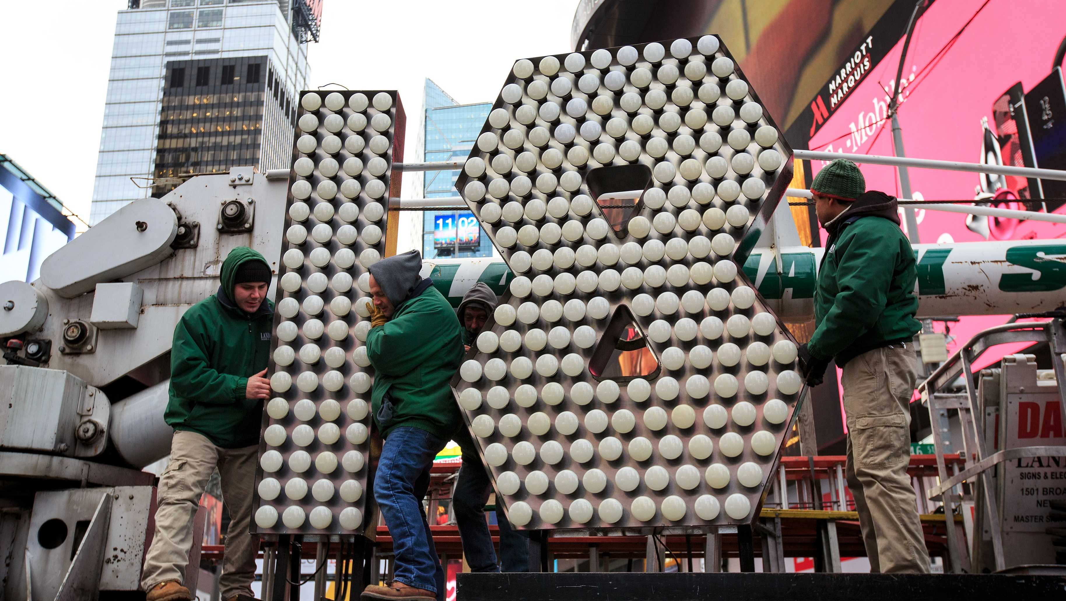 Workers unload the numerals 1 and 8 as they arrive in Times Square ahead of the New Year's Eve celebration, December 13, 2017 in New York City. The '18' numerals will be part of the '2018' sign that will light up light up above Times Square at midnight on December 31 to ring in the new year.