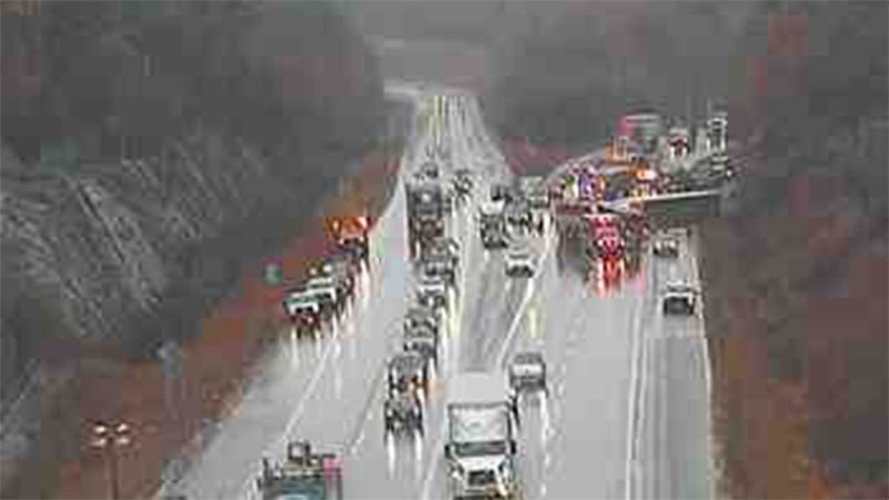 Tractor-trailer rolls over on I-93 in Manchester