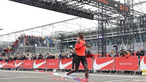 Olympic marathon champion Eliud Kipchoge crosses the finish line of a marathon race at the Monza Formula One racetrack, Italy, Saturday, May 6, 2017. Kipchoge was 26 seconds from making history on Saturday but in the end the Olympic champion was just short of becoming the first person to run a marathon in less than two hours. Kipchoge ran the 26.2 miles (42.2 kilometers) in 2 hours and 25 seconds, beating Dennis Kimetto's world record of 2:02:57, but the Kenyan failed to run the first sub-two hour marathon.