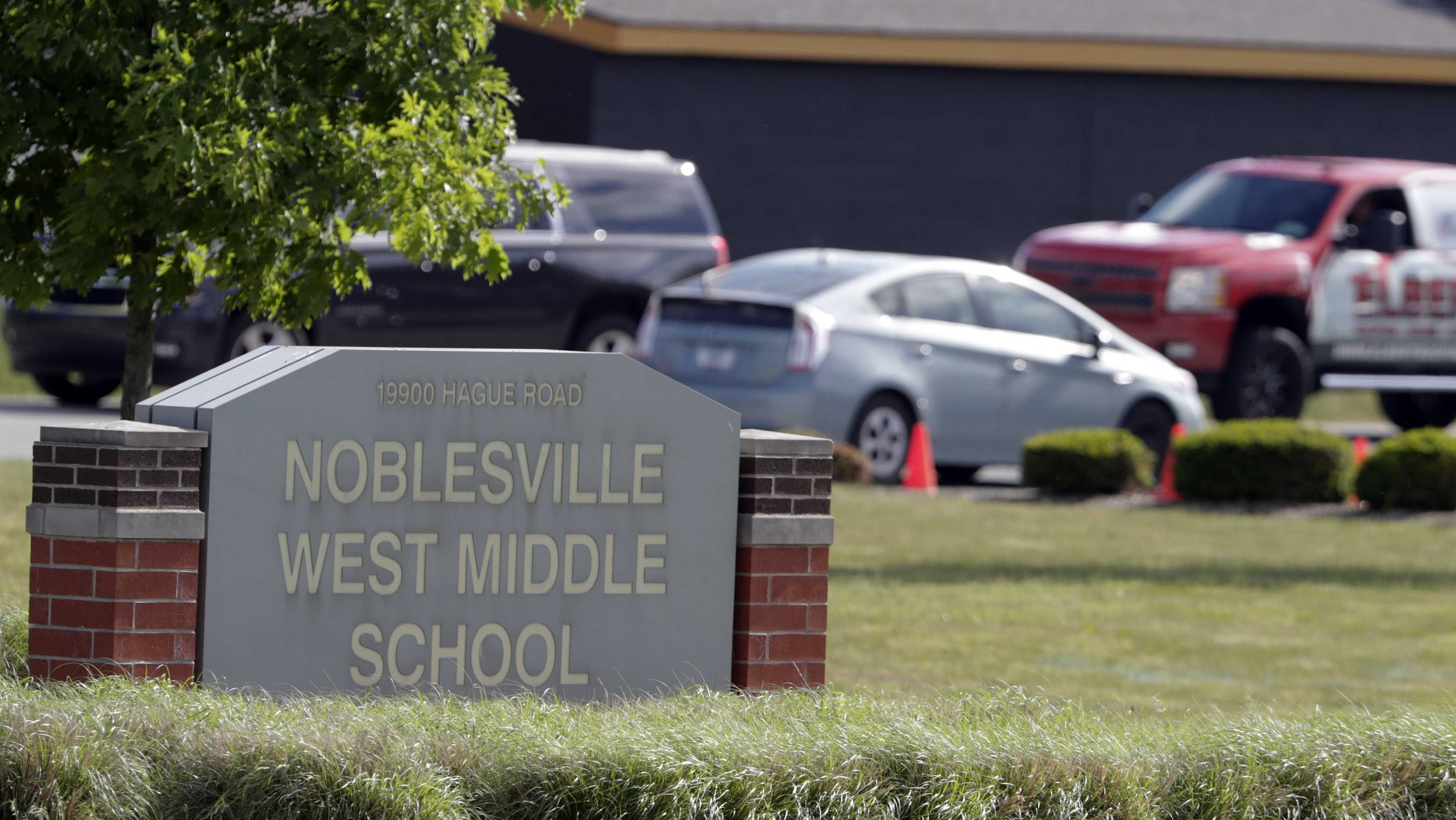 Parents drive students to school at Noblesville West Middle School a week after a shooting in Noblesville, Ind., Wednesday, May 30, 2018.