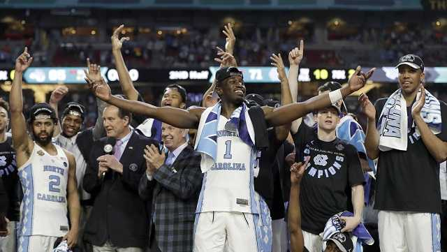 North Carolina's Theo Pinson (1) and the rest of the team celebrate after the finals of the Final Four NCAA college basketball tournament against Gonzaga, Monday, April 3, 2017, in Glendale, Ariz. North Carolina won 71-65.