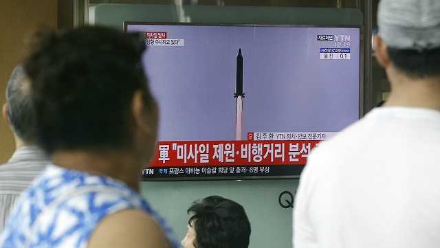 People watch a TV news program showing a file image of a missile being test-launched by North Korea, at the Seoul Railway Station in Seoul, South Korea, Tuesday, July 4, 2017.