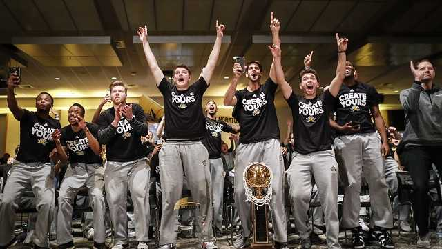 The Northern Kentucky men's basketball team celebrates after their matchup against Kentucky was announced for the NCAA tournament, Sunday, March 12, 2017, in Highland Heights, Ky. NKU secured an automatic berth after winning the Horizon League championship to become the second team since 1970 to be selected for the tournament in its first eligible season.