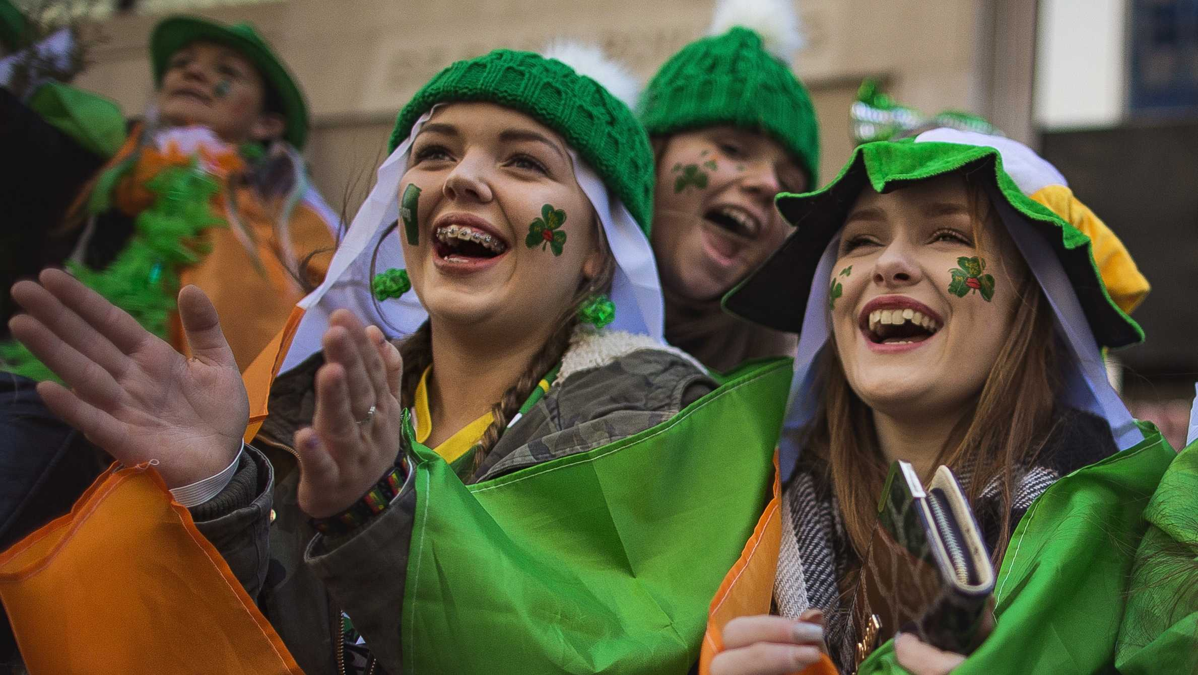 Spectators watch as revelers march up Fifth Avenue during last year's St. Patrick's Day Parade in New York City.