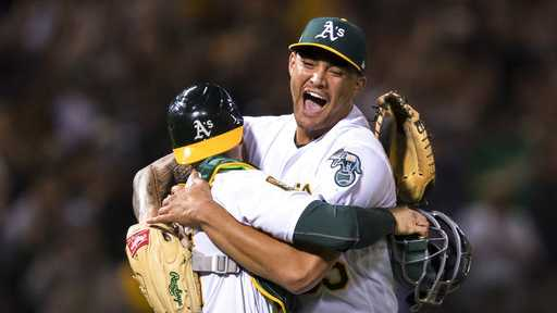 Oakland Athletics starting pitcher Sean Manaea, right, celebrates with catcher Jonathan Lucroy after pitching a no-hitter against the Boston Red Sox during a baseball game in Oakland, Calif., Saturday, April 21, 2018.