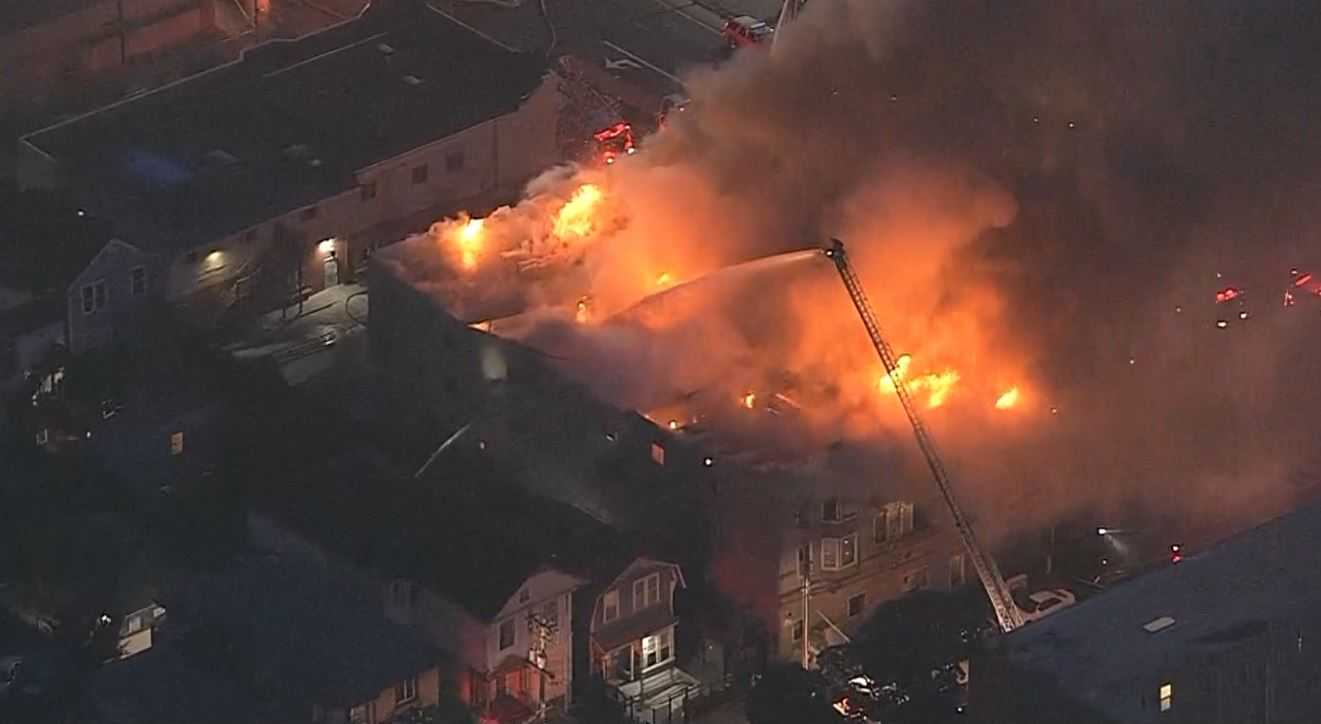 Flames, smoke shoot out from Oakland building