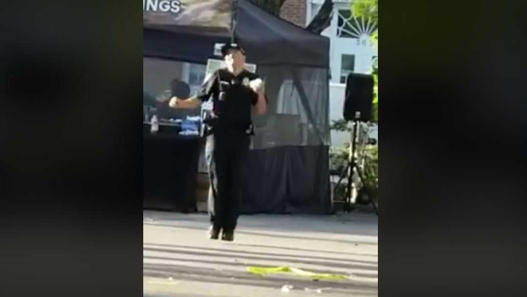Officer dances at Rice Festival