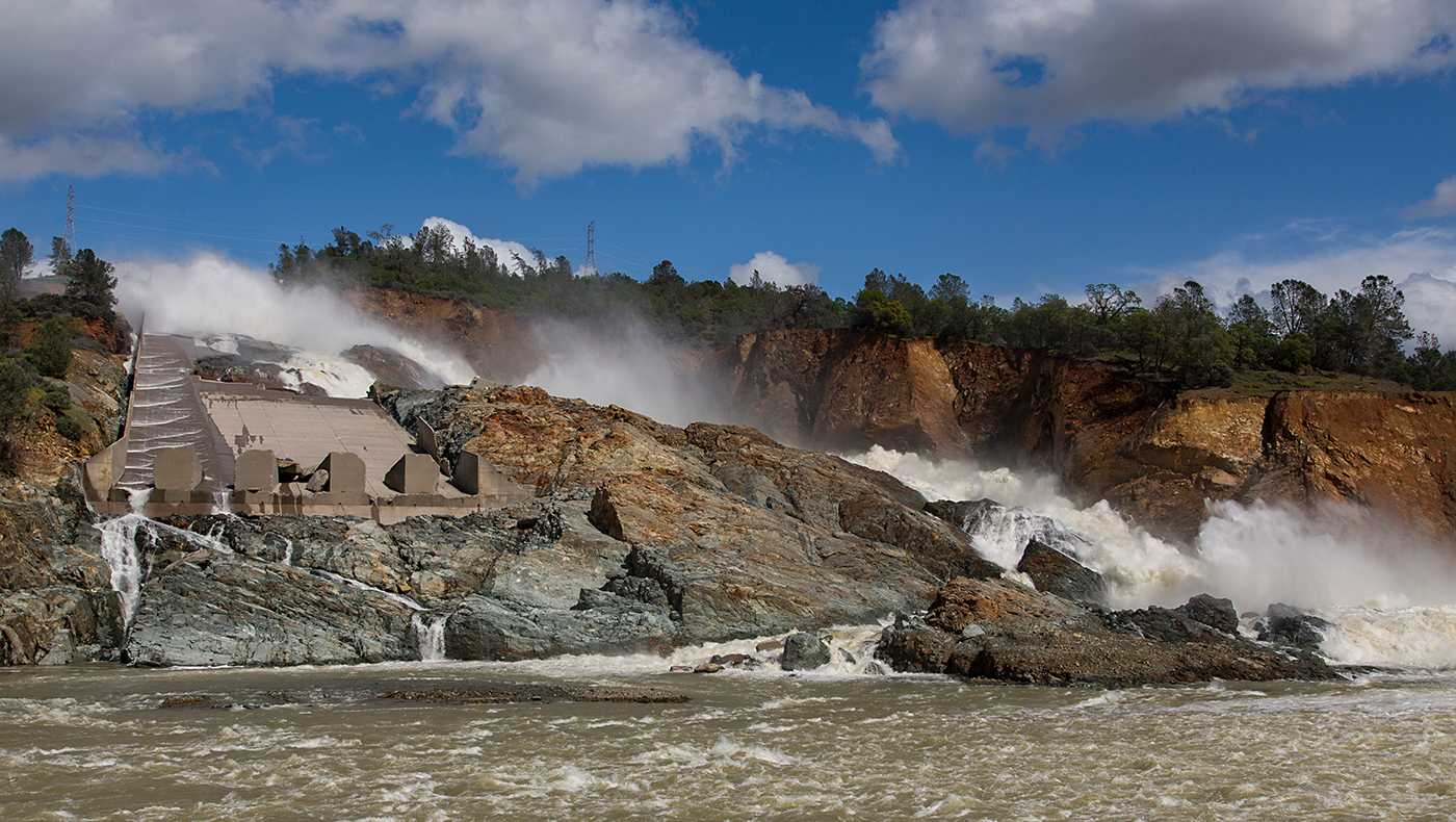 Water from the Lake Oroville main spillway rushed into the diversion pool from a ravine created by the spillway incident. The California Department of Water Resources continues to release water from Lake Oroville at an outflow of 40,000 cubic feet per second (cfs) to leave sufficient storage for the inflow of spring rains and snowmelt. Photo taken March 21, 2017.