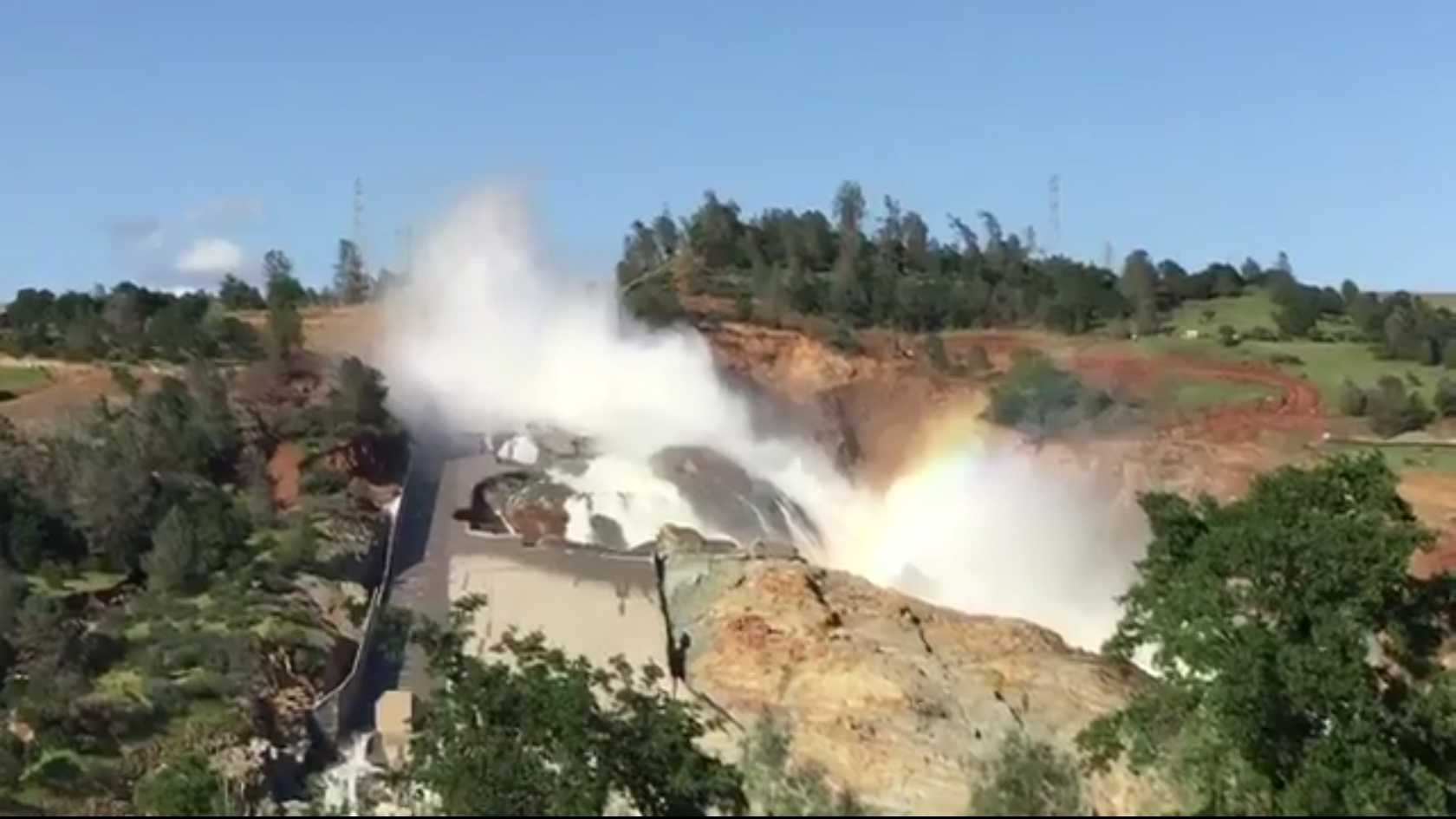 Water flows down the damaged main spillway at Lake Oroville on Tuesday, April 18, 2017.