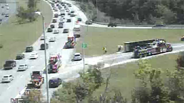 tractor-trailer overturned on 295 off-ramp to 695