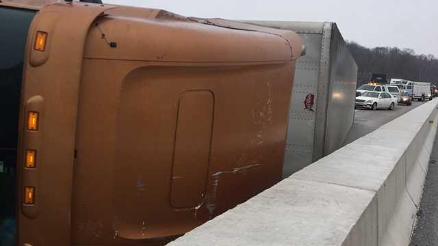 overturned tractor trailer on Tydings Bridge
