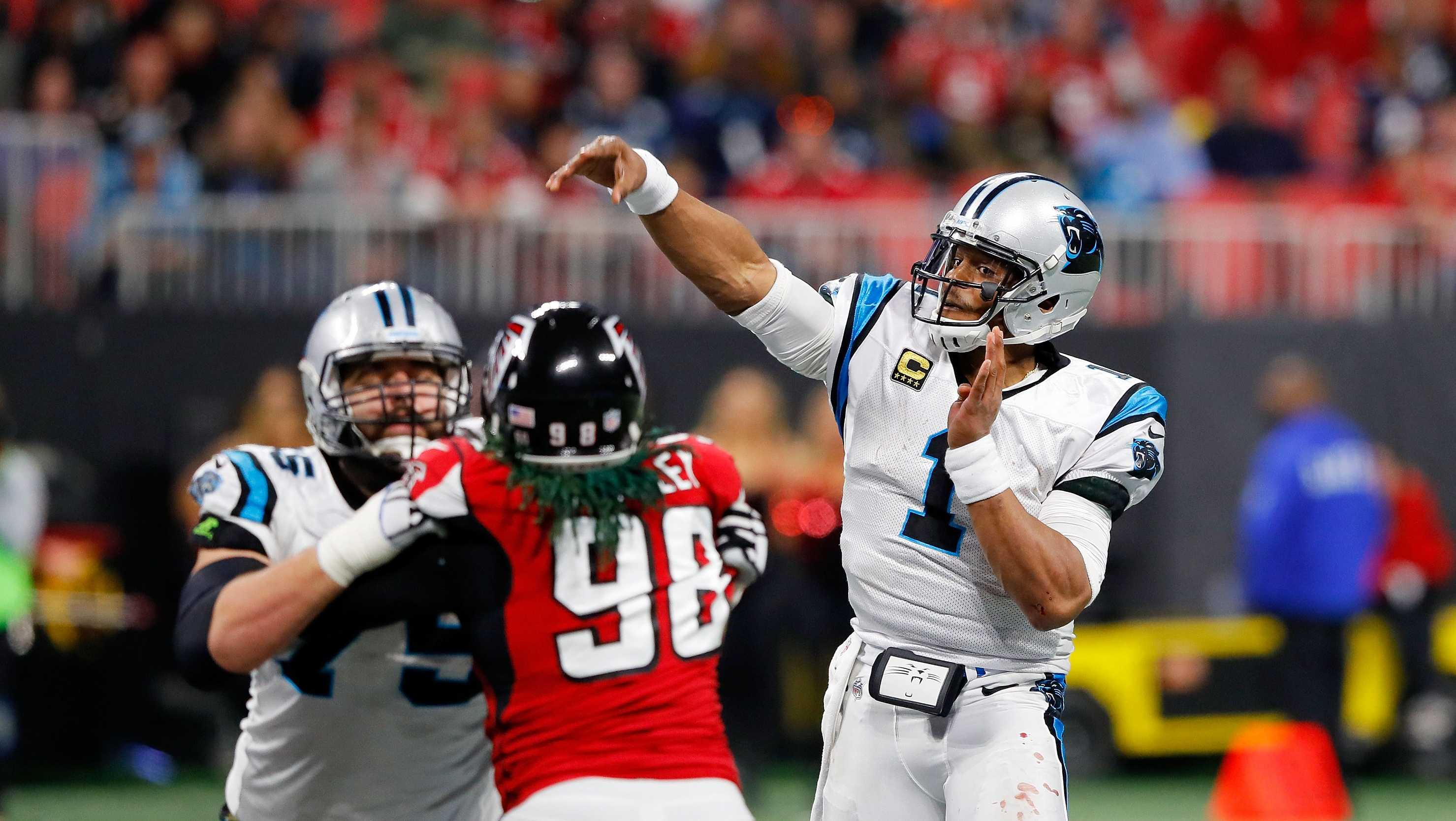 Cam Newton #1 of the Carolina Panthers throws a pass during the second half against the Atlanta Falcons at Mercedes-Benz Stadium on December 31, 2017 in Atlanta, Georgia.