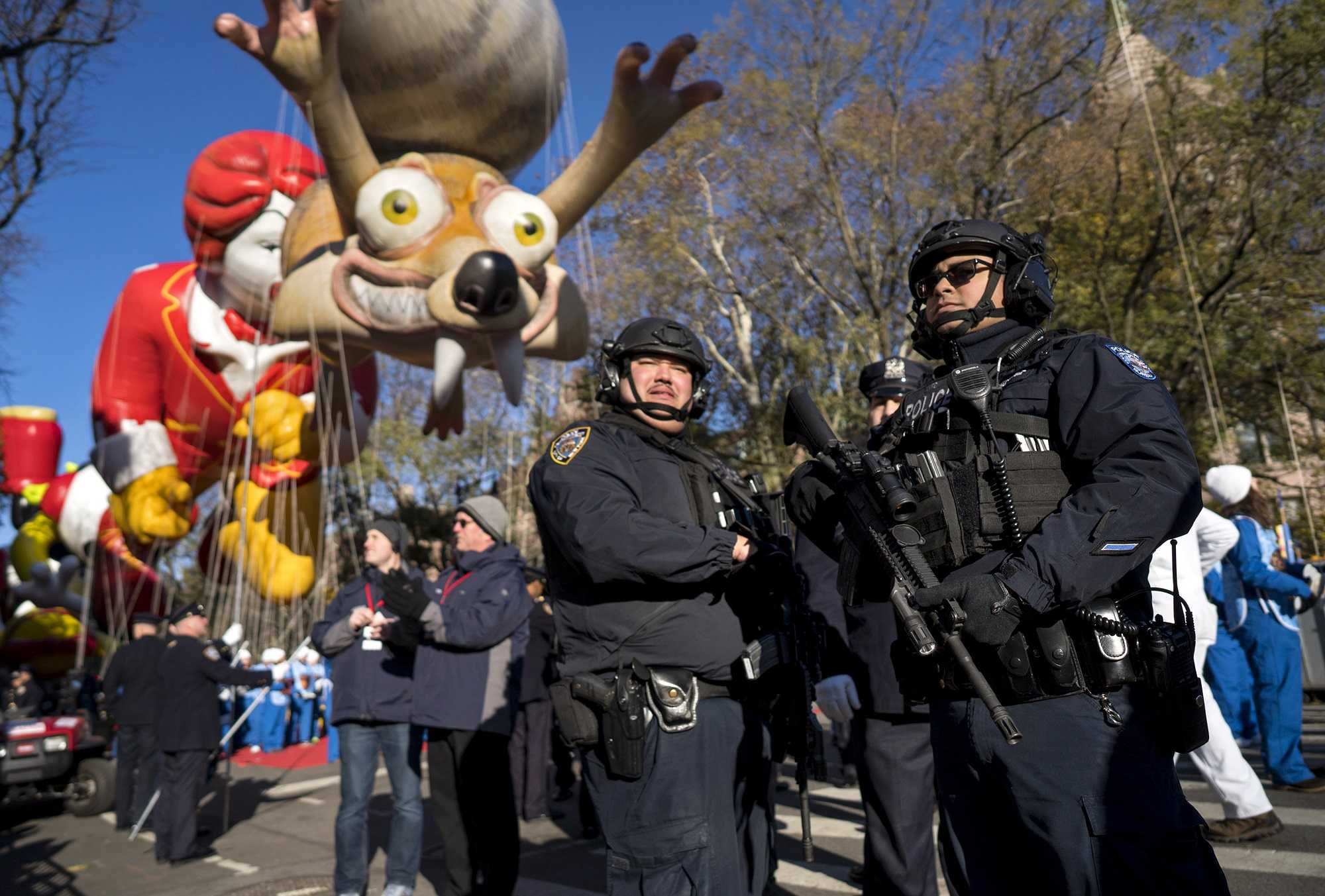 Macy's parade begins with balloons, bands and security