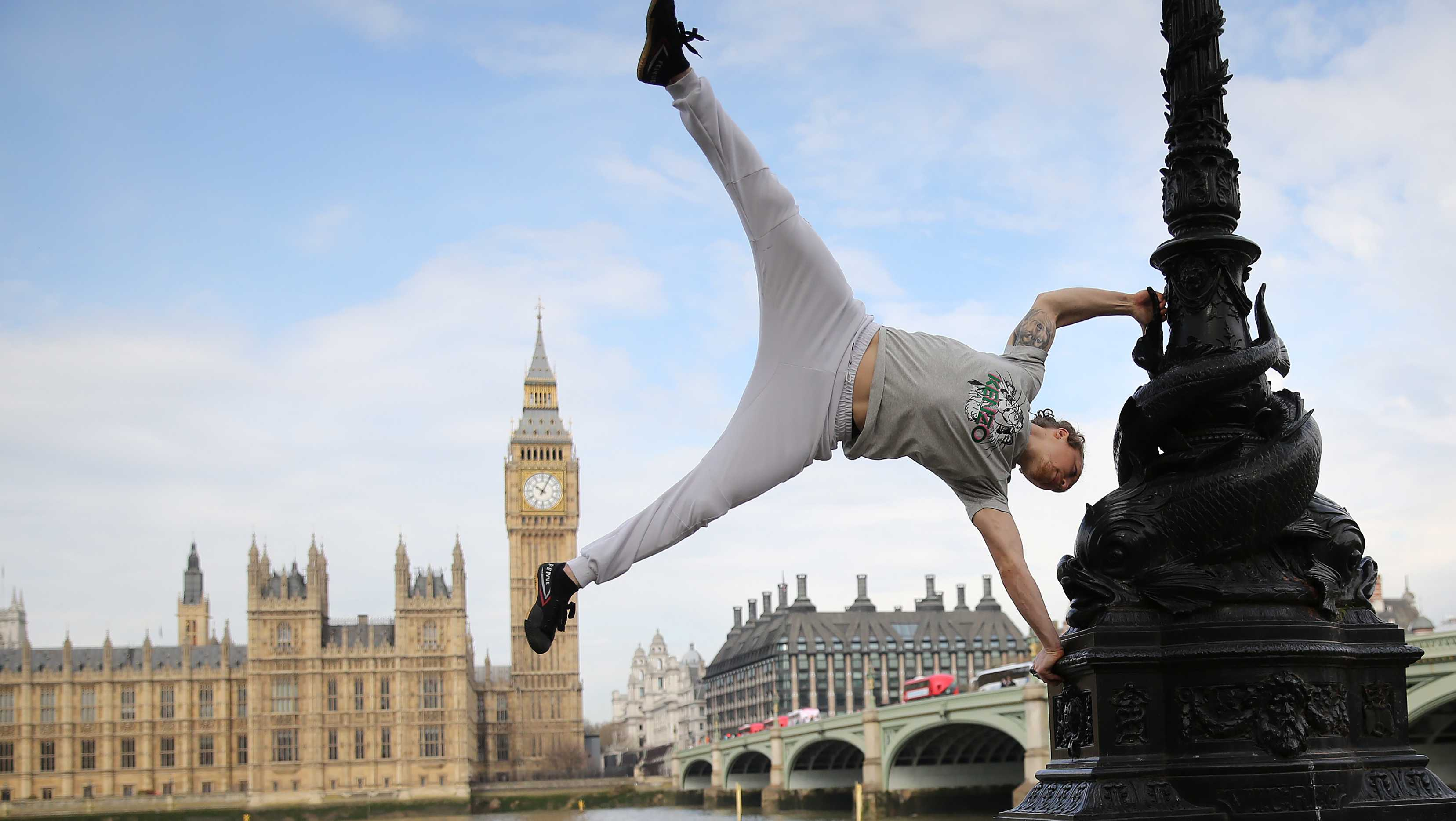 British Parkour expert Tim Shieff performs a hand-stand in front of the House of Commons, as he launches Jungle Book inspired Parkour masterclasses on London's Southbank.