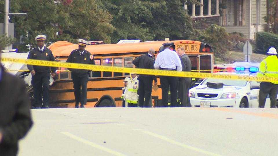 Investigators examine the scene after an MTA and a school bus collided in southwest Baltimore. Six people died and 10 others were injured in the crash.