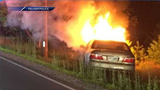 Officers drag man out of burning auto in Pelham, arrest him