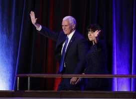 Vice-President-elect Mike Pence and his wife Karen Pence waves as they arrive during his election night rally.