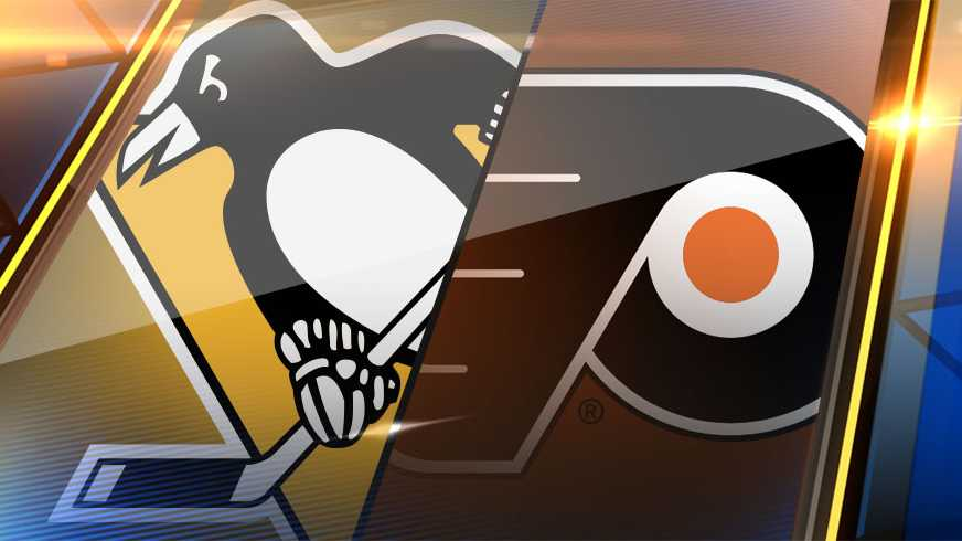 ... prepares to redirect a shot past Philadelphia goaltender Brian Elliott,  his first of three goals in the Penguins' 7-0 win over the Flyers on  Monday, ...